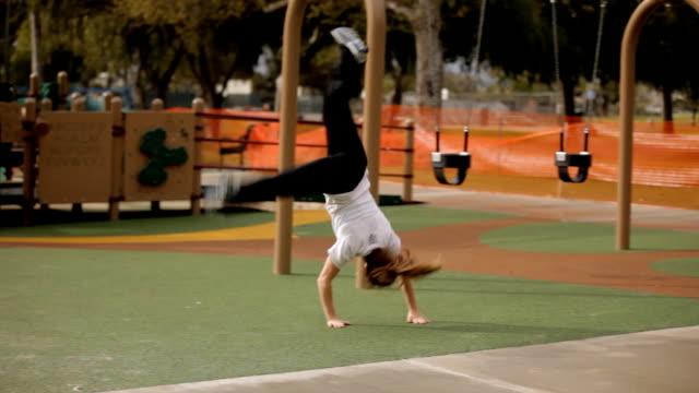 Parkour Girl Tumbles on Playground video