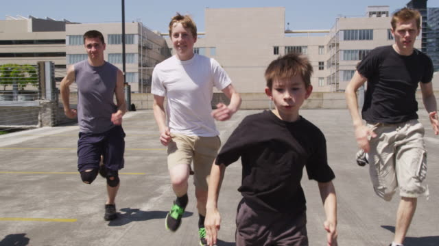 Parkour guys run, slow motion