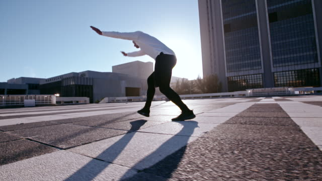 parkour in the urban space - gymnastics stock videos and b-roll footage