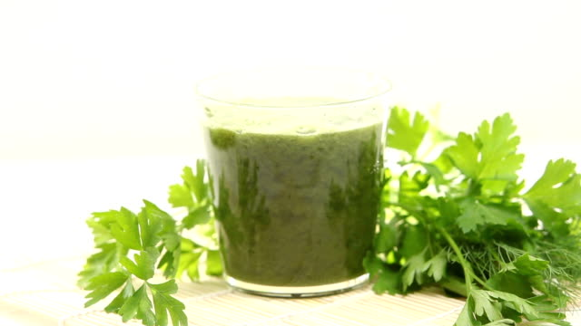 parsley and celery juice in glass on  table video