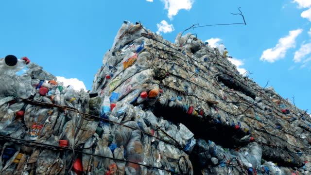 part of a waste deposit in the open air containing plastic junk. - mucchio video stock e b–roll