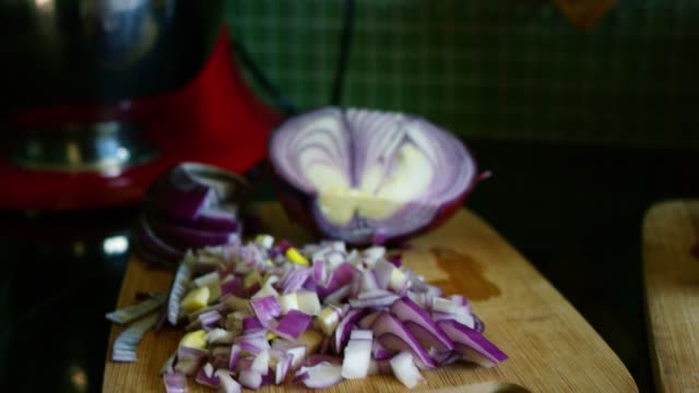 A Partially Chopped Red Onion Sits On A Wooden Cutting Board Before It Is Cooked In A Pan For Breakfast
