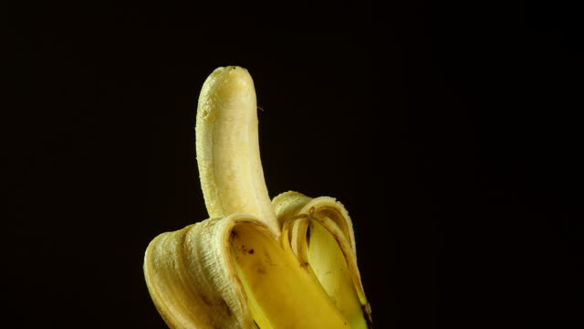 Partially peeled ripen banana fruit 1080p : partialy peeled ripen banana fruit peeled stock videos & royalty-free footage