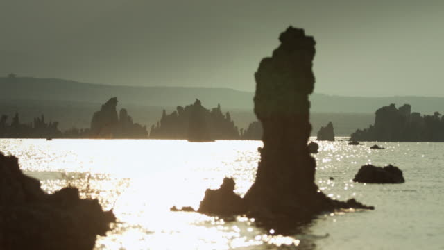 Partially Silhouetted Tufa Towers on Mono Lake at Sunset video