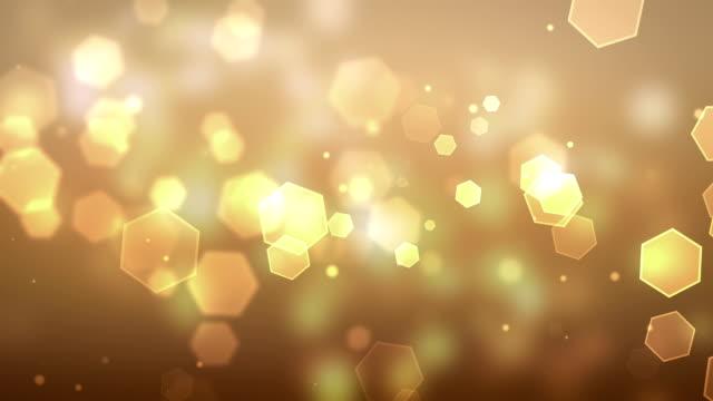 particella giallo sfondi loopable - esagono video stock e b–roll