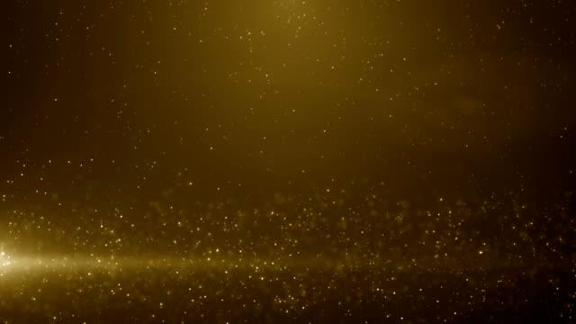 vídeos de stock, filmes e b-roll de partículas de ouro glitter bokeh prêmio poeira fundo abstrato loop - padrão repetido