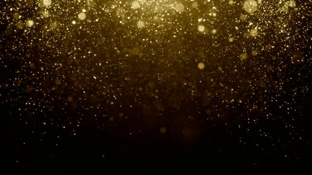Deeltjes gouden glitter bokeh award stof abstracte achtergrond lus video