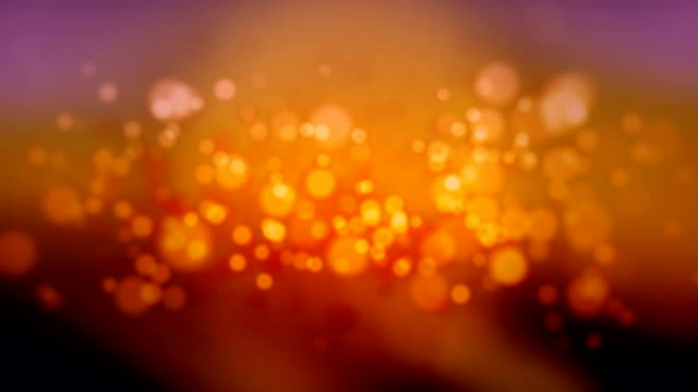 particles  loopable - arancione video stock e b–roll