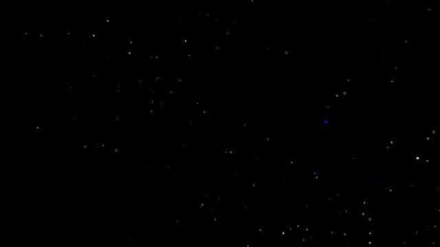 partikel auf schwarzem hintergrund. - gemahlen stock-videos und b-roll-filmmaterial