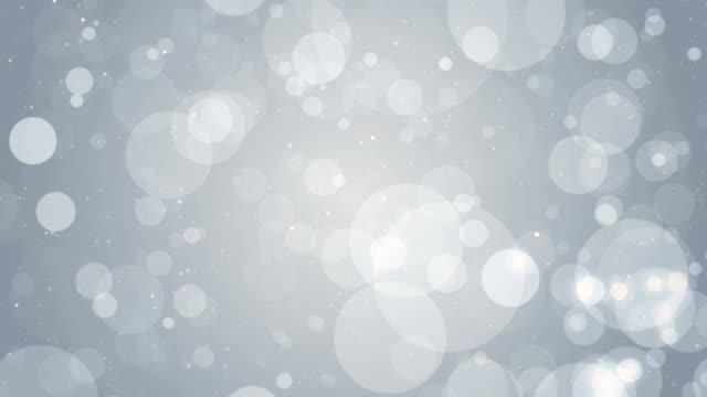 parçacıklar iş parlak parıltı bokeh toz arka plan döngü beyaz - bling bling stok videoları ve detay görüntü çekimi