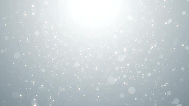 partikel weiß geschäft hell glitzer bokeh staub abstrakten hintergrund schleife - bling bling stock-videos und b-roll-filmmaterial