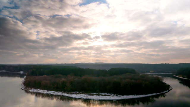 partly cloudy weather over the winter river, time-lapse video