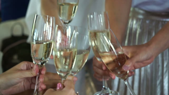 party drinking and toasting champagne in party video