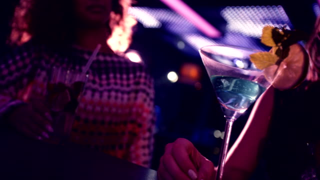 Party girls happy toasting martinis at nightclub video