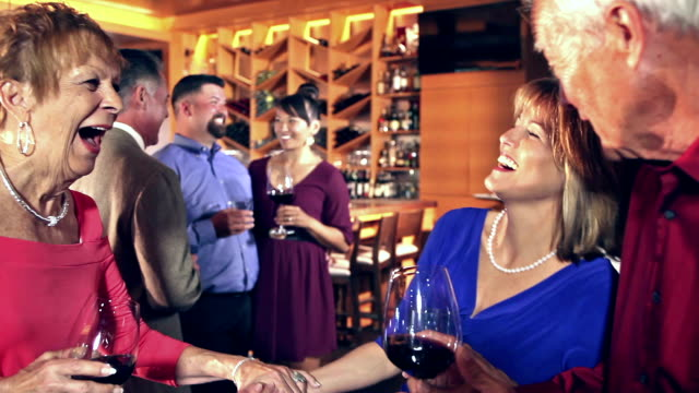 party in restaurant, waitress serving wine - office party stock videos and b-roll footage