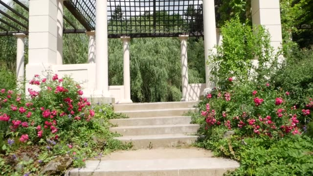 passage through the garden colonnade with old columns - classical architecture stock videos & royalty-free footage
