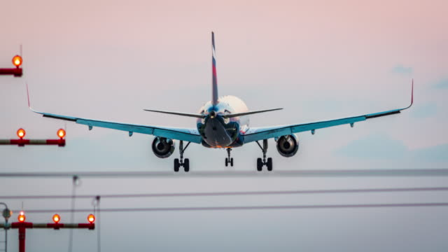 Passenger airplane landing at dusk