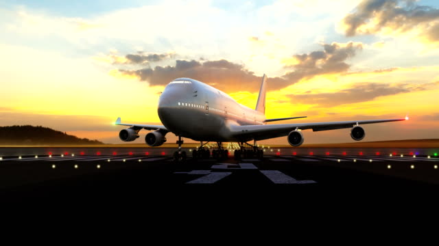 Passenger airplane preparing for take-off Passenger airplane taxiing into line up position against scenic sunset. The airplane preparing for take off and turning on take-off lights at standing start / takeoff position. Beautiful sunset. airfield stock videos & royalty-free footage