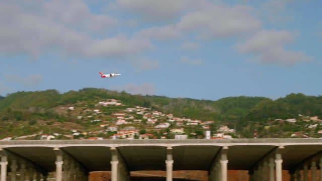 Passenger airplane takes off flight strip of Madeira airport video