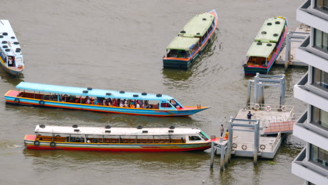 Passenger boats transport in Chaophraya river Passenger boats transport in Chaophraya river Bangkok, Thailand, 4k video lamp shade stock videos & royalty-free footage