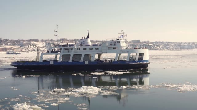 Passenger Ferry crosses the frozen St Lawrence river from Levis to Quebec City