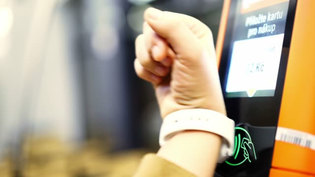 passenger payment smartwatch in public transport - computer indossabile video stock e b–roll