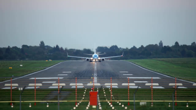 Passenger plane take-off from Hannover airport at sunset video