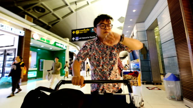 A Passenger running to check-in counter in airport terminal with luggage cart after final call. Worst Holiday Concept. Worst Holiday Concept catching stock videos & royalty-free footage