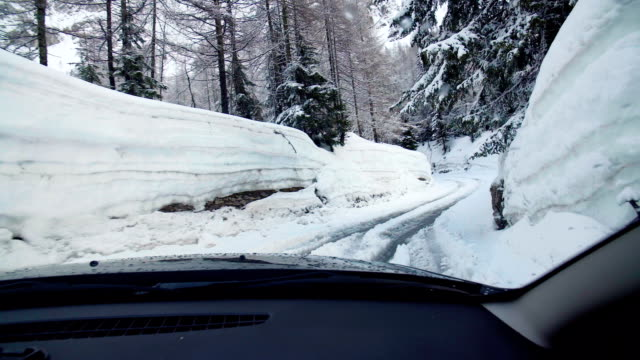Passenger seat view driving an suv trugh deep snow Passenger seat view driving an suv trugh deep snow vinter stock videos & royalty-free footage