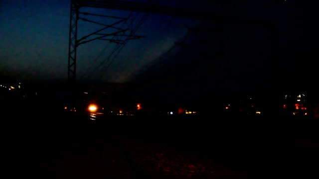 Passenger train entering in to the station at night Passenger train entering in to the station at night intercity stock videos & royalty-free footage