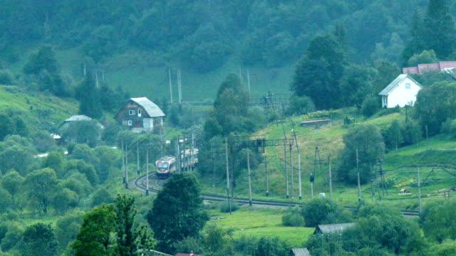 passenger train rides through the forest timelapse - karpaterna tåg bildbanksvideor och videomaterial från bakom kulisserna