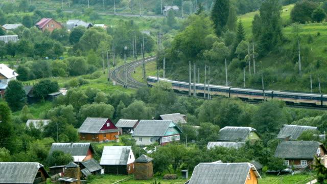 passenger train rides through the forest - karpaterna tåg bildbanksvideor och videomaterial från bakom kulisserna