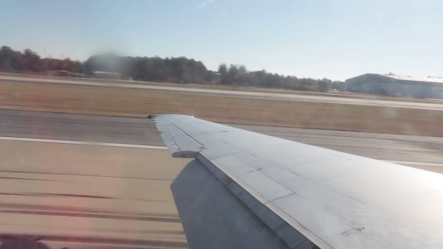Passenger view from airplane window during landing - video