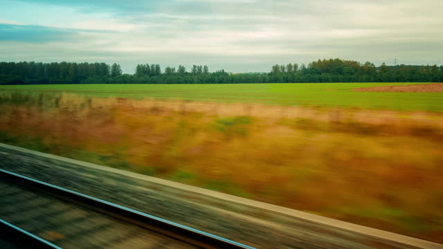 Passenger view of a train journey across the UK countryside video