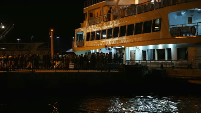 Passengers and Ship at Night as Time Lapse video
