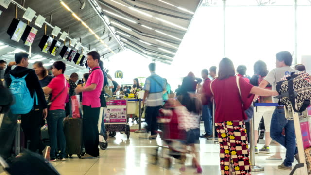 Passengers at Airport Check In Counter,Panning Shot video