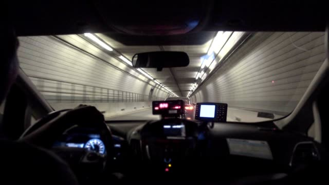 passenger's backseat view inside a taxi in a boston tunnel - rideshare stock videos and b-roll footage