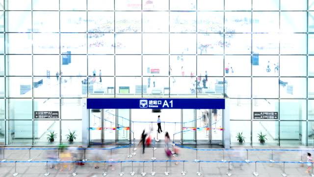 passengers enter railway station hall interior,time lapse. - billboard train station bildbanksvideor och videomaterial från bakom kulisserna