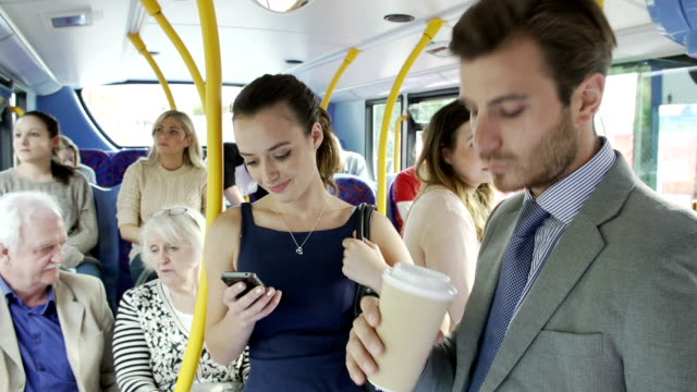 passengers standing on busy commuter bus - bus stock videos and b-roll footage