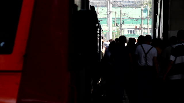 Passengers take off from the train / Russia. Moscow video
