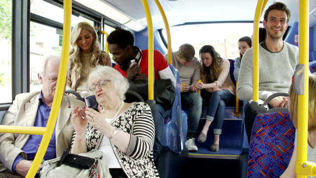 Passengers Using Mobile Devices On Bus Journey video