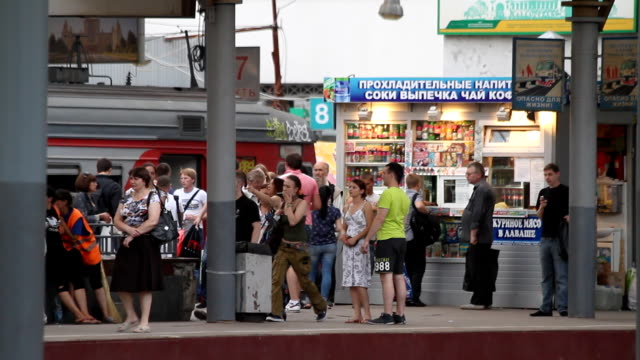 Passengers waiting for a train on the platform / Russia. Moscow video