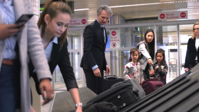 Passengers waiting for baggage at airport