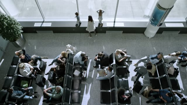 passengers waiting in lower and upper floor of the airport - airports stock videos & royalty-free footage