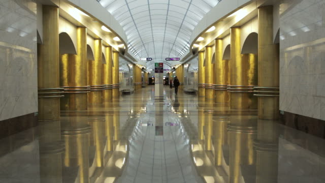 passengers walking in empty metro station in saint petersburg russia - subway video stock e b–roll