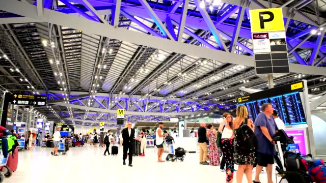 Passengers walking in Suvanaphumi Airport, Bangkok Bangkok, Thailand. Suvarnabhumi Airport is one of two international airports serving Bangkok, Thailand. airfield stock videos & royalty-free footage