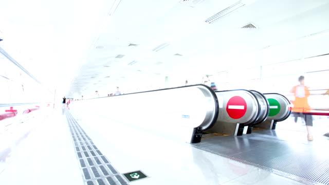 passengers walking in the airport corridor,timelapse video