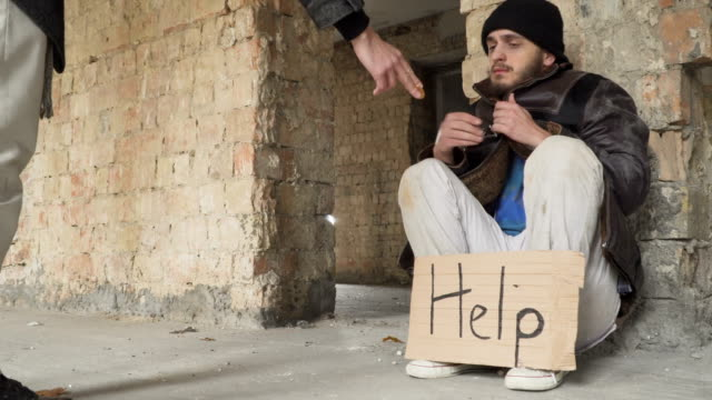 Passer man gives bitcoin to homeless video