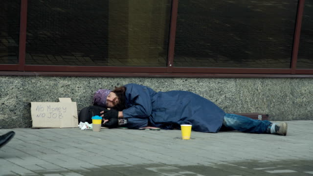 passerby giving money to beggar - homelessness stock videos & royalty-free footage