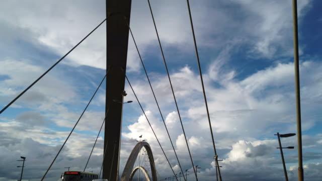 passing at famous cable-stayed bridge in brasilia. jk bridge. - cavo d'acciaio video stock e b–roll